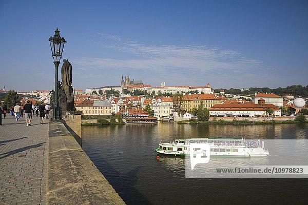 'Charles Bridge And Tour Boat On The Vltava River; Prague  Czech Republic'