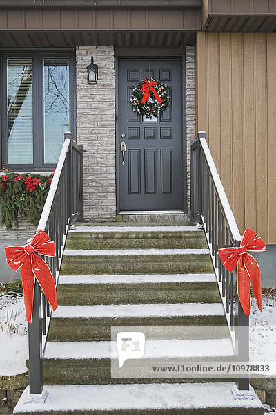'House With A Christmas Wreath On The Front Door; Quebec Canada'