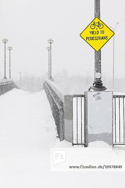 'Pedestrian walkway/bikepath on a snowy day; Winnipeg  Manitoba  Canada'