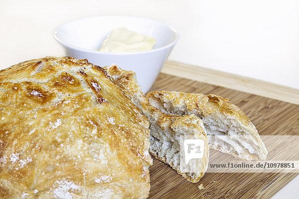 Homemade bread on bamboo cutting board