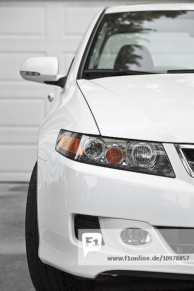 'White sport sedan car  parked in driveway  close up  front view; Winnipeg  Manitoba  Canada'