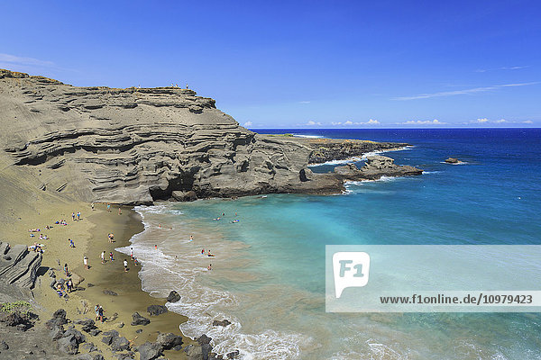 'Green Sand Beach  or Papakolea Beach  is a hike from South Point Hawaii and is know for the distinct color from olivine mineral; Naalehu  Island of Hawaii  Hawaii  United States of America'