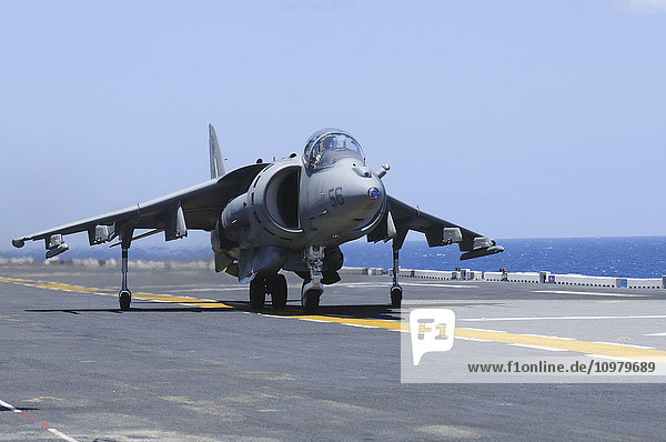 'An AV-8B Marine Harrier II lands on the flight deck of the USS Peleliu (LHA-5) during flight operations in the Pacific Ocean; Hawaii  United States of America'