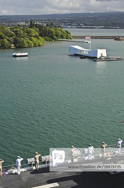 'Sailors and Marines render honors to the USS Arizona Memorial in Pearl Harbor; Oahu  Hawaii  United States of America'