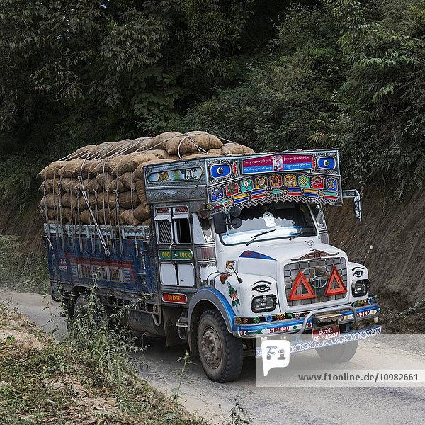 'A colourful truck loaded with brown sacks; Thimphu  Bhutan'