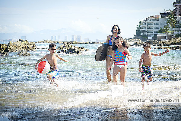 Mexico  Puerto Vallarta  mother and three children having fun at seafront