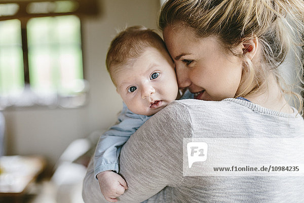 Mother with baby boy at home