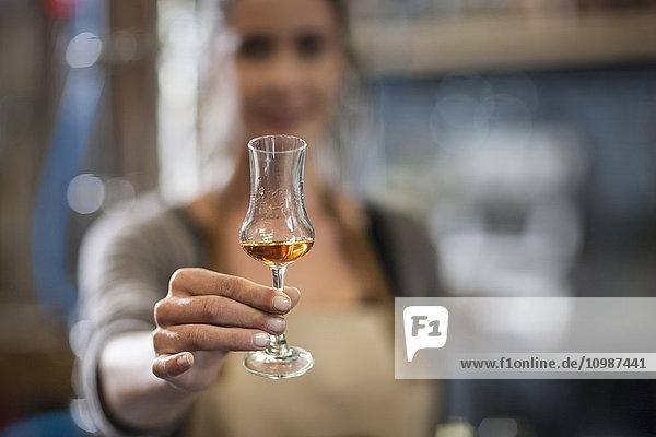 Woman holding liquor glass
