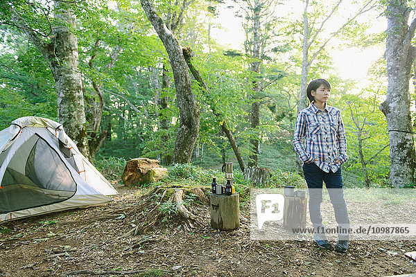 Young Japanese woman at a camp site
