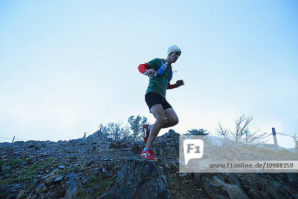 Caucasian man running at Mount Daibosatsu  Yamanashi Prefecture  Japan