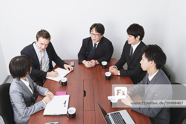 Multi-ethnic business people in a meeting room