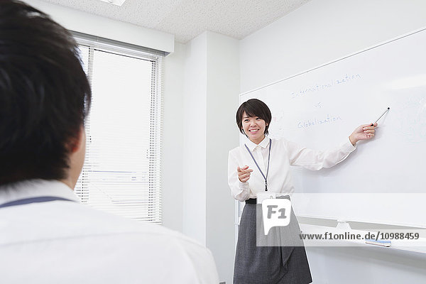 Young Japanese businesswoman in a meeting room