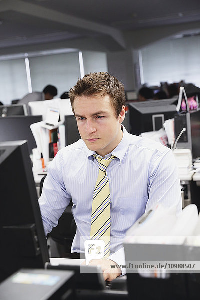 Caucasian businessman working late at his desk