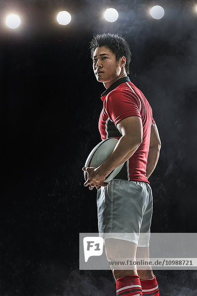 Portrait of Japanese rugby player with ball