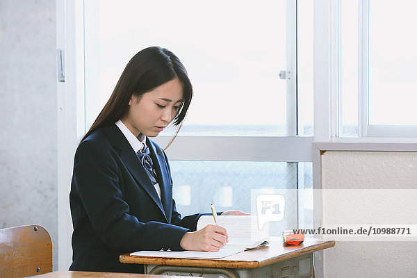 Japanese high-school student in empty classroom