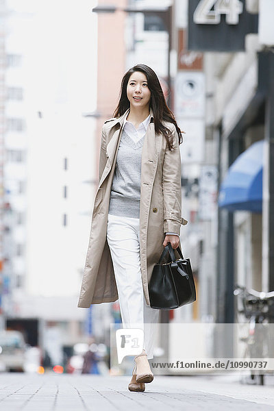 Young attractive Japanese woman downtown Tokyo