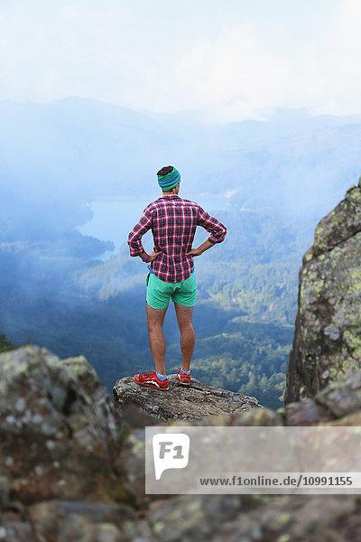 Caucasian man enjoying the view after a mountain hike