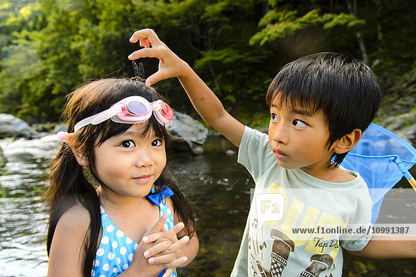Japanese kids playing at the river