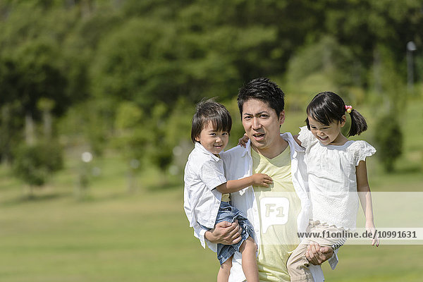 Kids with dad at the park