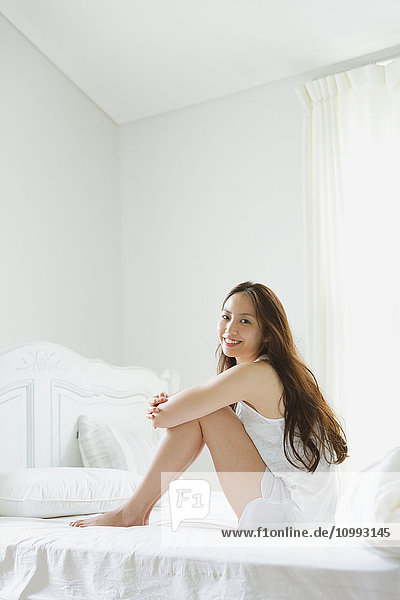 Young attractive Japanese woman in bed