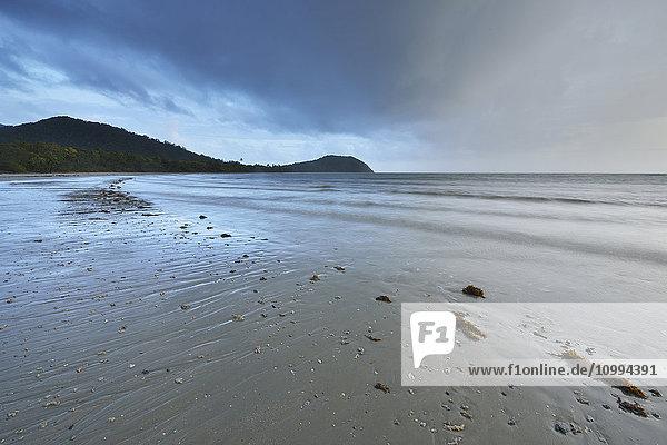 Sandy Beach with Storm Clouds in Morning  Daintree Rainforest  Cape Tribulation  Queensland  Australia