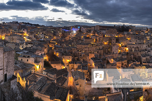 Overview of Sassi di Matera at dusk  one of the three oldest cities in the world  Basilicata  Italy