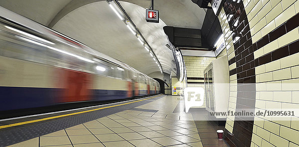 View of London Underground Platform at Edgware Road with Train Leaving  London  England  UK