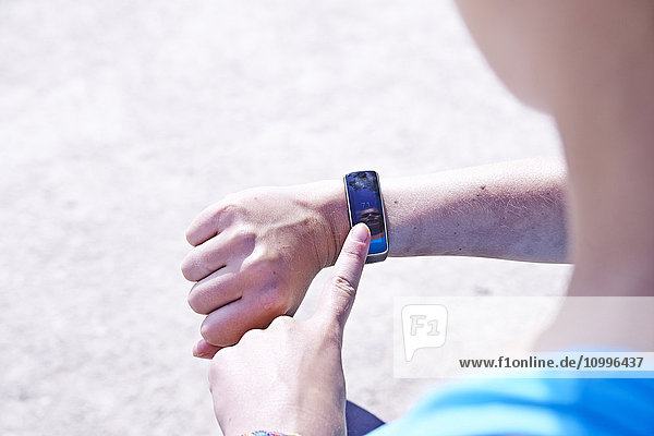 Woman checking her connected bracelet.