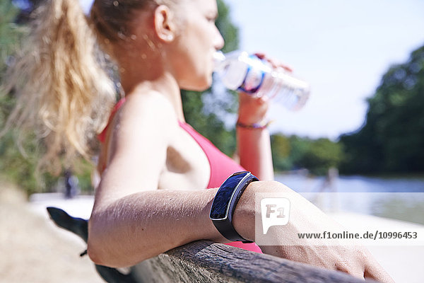 Jogger drinking water.