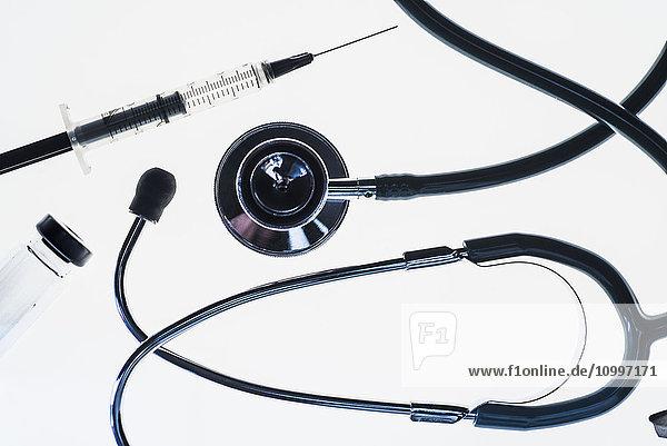 Stethoscope  syringe and test tube on white background