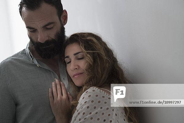 Mid-adult couple hugging
