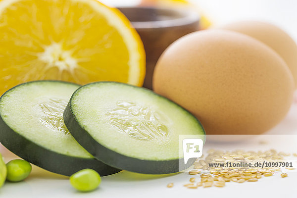 Eggs with slices of cucumber and orange