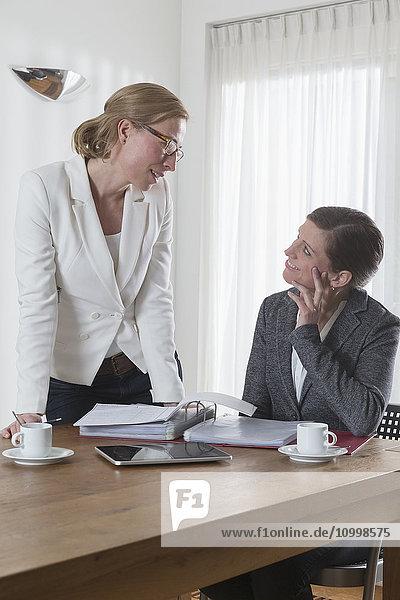 Businesswomen chatting at office