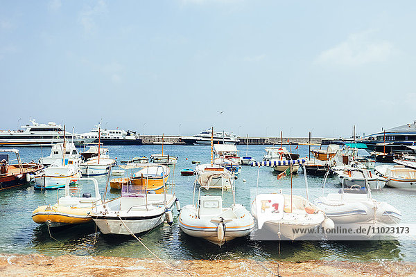 Boats moored on shore at Marina Grande against sky
