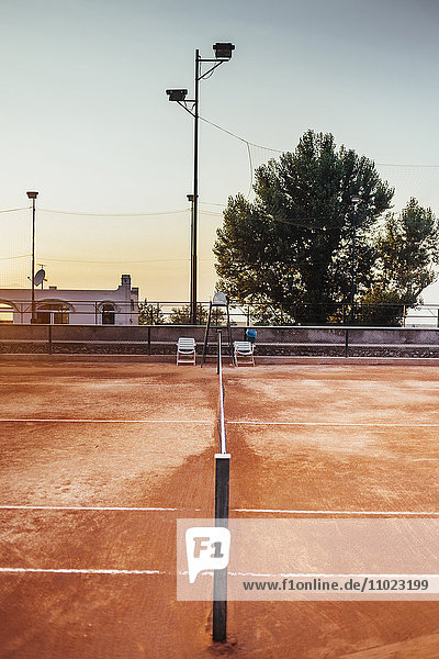 Empty tennis court against clear sky