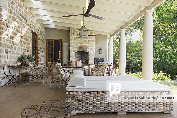 Luxury home showcase patio with stone walls