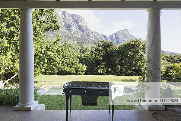 Foosball table on luxury patio overlooking mountains
