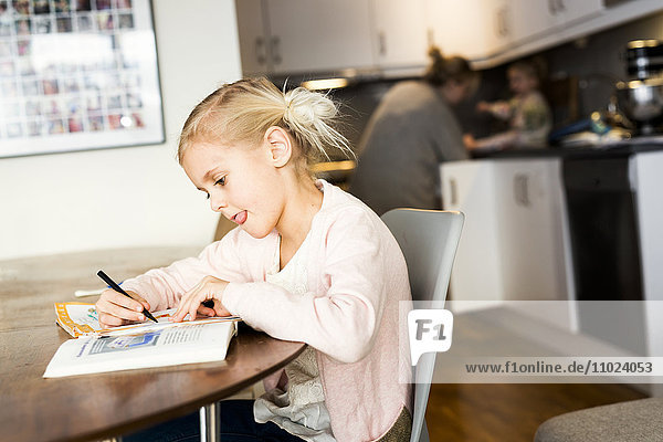 Girl studying on table at home