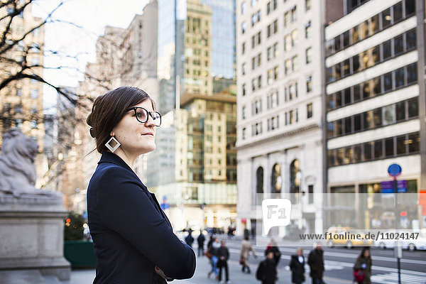 Side view of businesswoman waiting outside New York Public Library