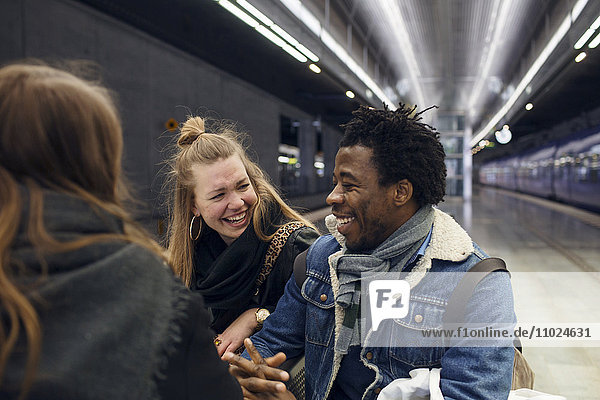 Happy friends enjoying at subway station