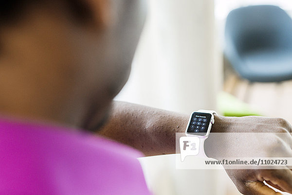 High angle view of businessman wearing smart watch
