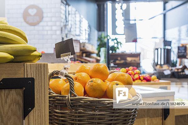 Oranges and bananas in supermarket