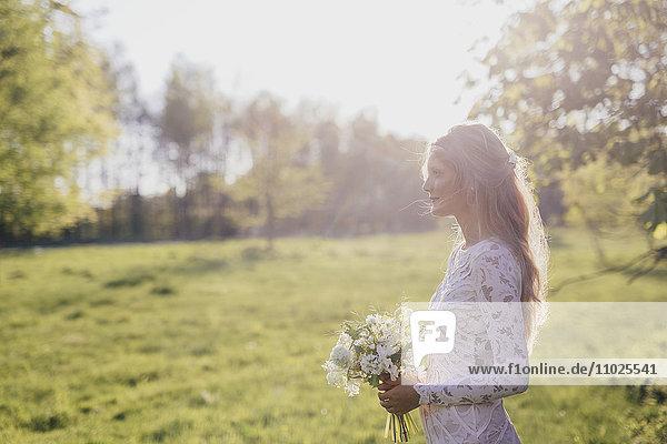 Beautiful bride in meadow Beautiful bride in meadow