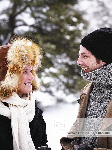 A man and a woman on a winter picnic.