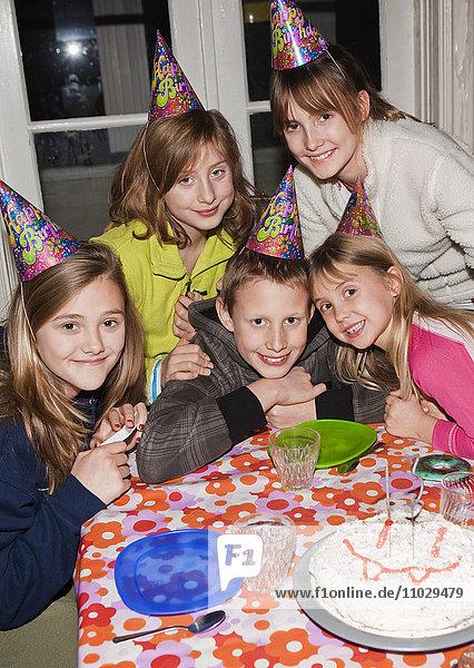 Group of children having birthday party