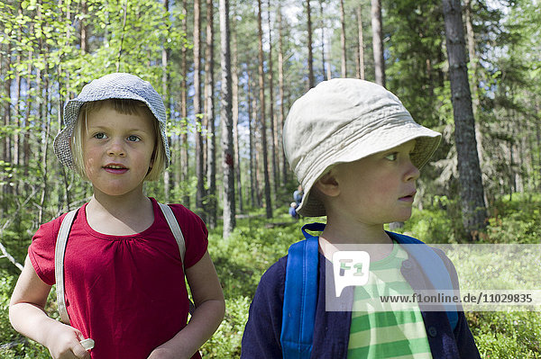 Boy and girl walking in forest