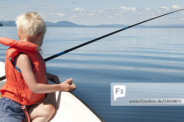 Boy fishing on boat