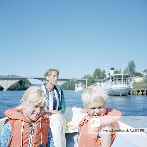 Mother with daughter and son on boat