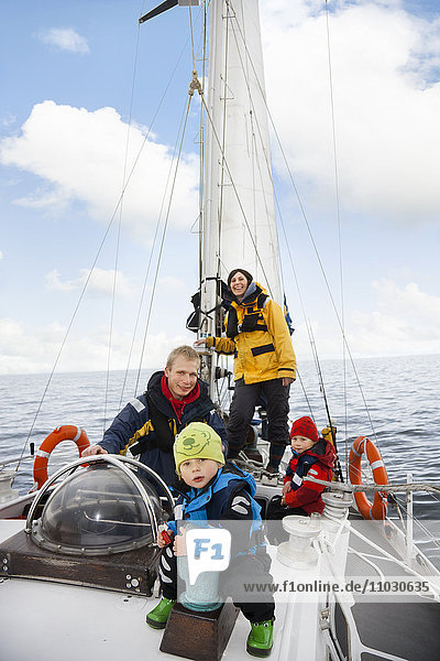 Family on sailing boat  smiling