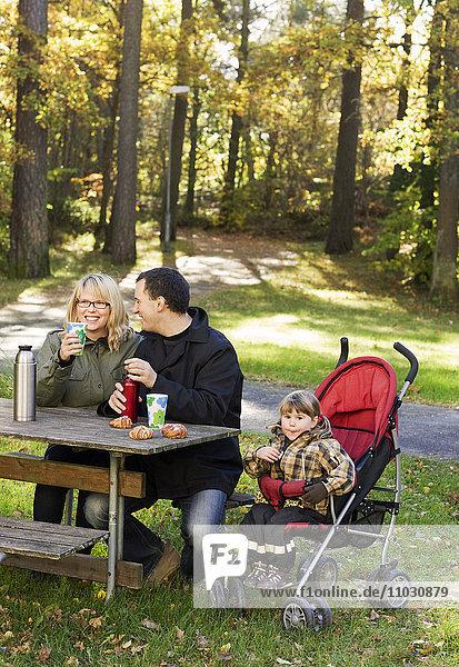 Family having coffee break outdoor